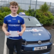 Darragh Cassidy posing with PASS certificate